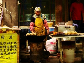 Muslim Chinese woman at her food stand