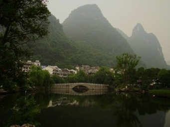 Yangshuo (阳朔) is a scenic, small town surrounded by mountains and beautiful scenery.
