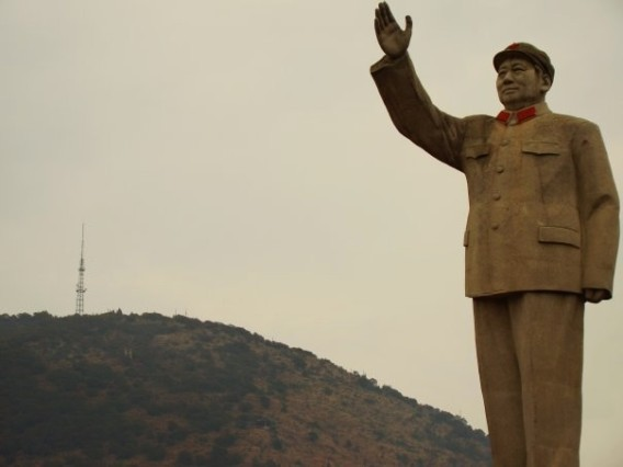 Chairman Mao. In a square near the business district. Taller than a mountain.