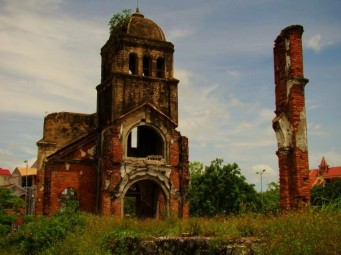 Destroyed church with one pillar left standing
